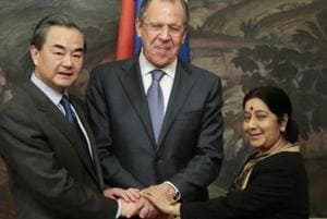 From left: Chinese foreign minister Wang Yi, Russian foreign minister Sergey Lavrov and external affairs minister Sushma Swaraj shake hands after a meeting in Moscow, Russia.