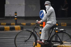 Delhi air pollution spikes again, rain forecast holds out hope