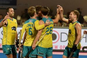 Australia hockey team players celebrate after scoring against Argentina in the gold-medal match of the FIH Men