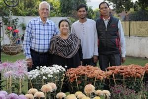 AK Sharma and his wife Pratibha along with their gardener Vanshraj Yadav (extreme right) and his son Manish Kumar at their house in Sector 8, Chandigarh on Sunday.