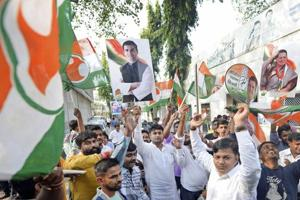 Congress party workers celebrate after Rahul Gandhi was declared the party president-elect, in Mumbai on Monday.
