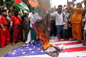 Indonesian Muslim groups burn US, Israeli flags over Trump's Jerusalem...
