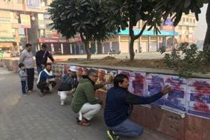 Citizens paint over illegal posters on walls of Greater Noida