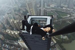 China warns against livestreaming after 'rooftopper' falls to death...