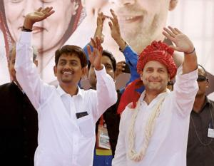 Congress president-elect Rahul Gandhi with the OBC leader Alpesh Thakor, who has joined the party, at a public meeting in Gandhinagar, Gujarat on Monday.