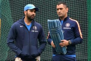 Indian cricket team stand-in skipper Rohit Sharma with MS Dhoni during a practice session on the eve of the second ODI against Sri Lanka cricket team in Mohali.