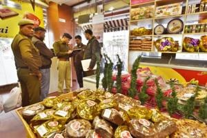 Gurgaon police at Harish Bakery on Old Railway Road. The accused fled the spot in chaos that ensued after the shot was fired.