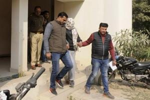 The boy who killed his mother and sister being taken by police personnel for medical tests in Greater Noida. (Sunil Ghosh/HTPhoto)