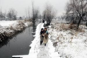 Photos: Northern India freezes with first snow of the season