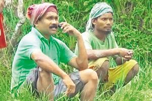Former Jharkhand CM Madhu Koda relaxes after cultivating his plot in native Patahatu village in West Singhbhum on July 23, 2017.