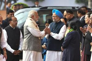 After war of words, Modi and Manmohan greet each other at Parliament...