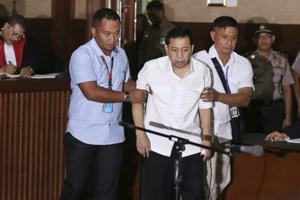 Indonesia politician's corruption trial delayed by stomach woes