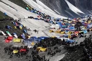The file picture shows Hindu pilgrims on a glacial campsite on the final stretch of their journey to the Amarnath cave shrine.