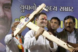 Rahul Gandhi being presented model of a plough by his supporters during a public meeting in Amreli, Gujarat.