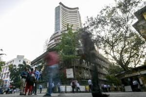 Late buying lifts Sensex; Himachal, Gujarat exit polls take...