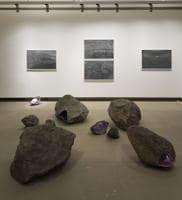 Artist Amshu Chukki's work includes fascinating landscape of rocks, much like the kind you'll find along the Deccan Plateau, and on the walls are his gorgeous charcoal drawings of stills from the videos.
