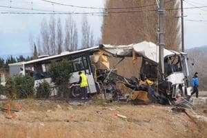 Death toll rises to six after school bus, train collide in France