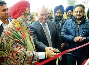 Irrigation and electricity minister Rana Gurjit inaugurating the paddy converts to pallets in Rajpura town on Friday, December 15, 2017.Photo by .