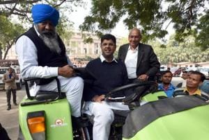 Member of Parliament Dushyant Chautala with other party leaders arriving on a tractor to attend the first day of the winter session in New Delhi on Friday.