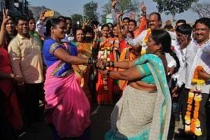 Shiv Sena workers celebrate after winning seats in Bhiwandi in Thane, Maharashtra.