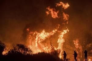 Photos: Wildfire Thomas California's third largest ever