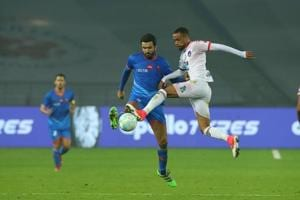 Jeroen Lumu of Delhi Dynamos FC and Ahmed Jahouh of FC Goa vie for the ball during an Indian Super League match in new Delhi on Saturday.