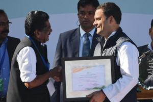Rahul Gandhi (C), newly elected president of Congress, receives a certificate of election from Mullapally Ramachandra, the chairman of the party's central election authority, as his mother and former president Sonia Gandhi and former Prime Minister Manmohan Singh (R) applaud during a ceremony at the party