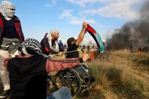 Palestinian who lost legs in 2008 clash killed by Israeli forces in...