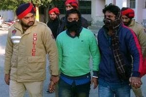 Police producing the two gangsters in a Talwandi Sabo court on Saturday.