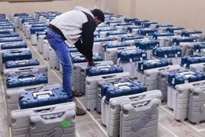 An election official arranging the Electronic Voting Machines (EVM) at a distribution centre before moving to their respective polling stations ahead of the second phase of polling, in Ahmedabad on December 13.