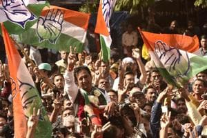 Congress candidate Imran Yusufbhai Khedawala shows victory sign in Ahmedabad on Monday.