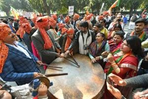 BJP workers and supporters celebrate party's success in Gujarat and Himachal Pradesh assembly elections, in New Delhi.