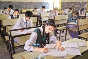 Students taking their board exams at a school in Bhopal. The CBSE said it has always relied on schools to depute experienced teachers for evaluation work. (HT File Photo)