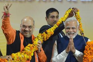 BJP wins Gujarat for the sixth time as Narendra Modi works his 'vikas'...
