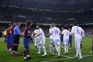 (File pic)FC Barcelona players form a guard of honour for La Liga champions Real Madrid before the start of the El Clasico La Liga match at the Santiago Bernabeu stadium on May 7, 2008.
