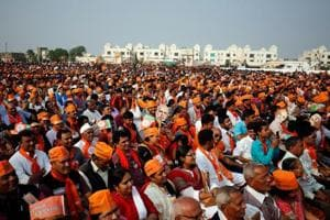 BJP supporters attend a campaign meeting addressed by Prime Minister Narendra Modi ahead of Gujarat state assembly election in Kalol on the outskirts of Ahmedabad, December 8, 2017.