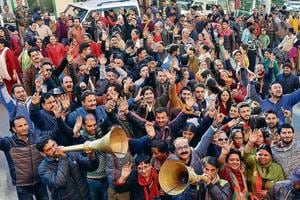 BJP supporters exuberant after the party's victory in the Himachal Pradesh Assembly elections in Shimla on Monday.