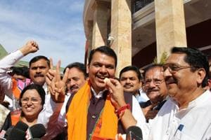 Chief minister Devendra Fadnavis celebrates BJP's victory in Gujarat and Himachal Pradesh with other party members outside Vidhan Bhavan in Nagpur on Monday.
