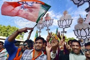 BJP workers celebrate their victory in the assembly elections near the party office