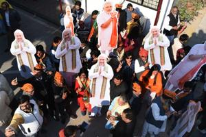 BJP supporters celebrate the party's win in the Gujarat and Himachal Pradesh assembly elections in New Delhi.