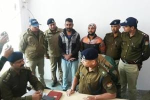 Haridwar police arrested two contract killers, who were out to shoot down a Dehradun-based property dealer, from an overbridge near Roorkee on Tuesday.