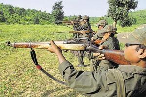 Maoist rebels train in a forest area at Dumariya block in Gaya district in of Bihar.