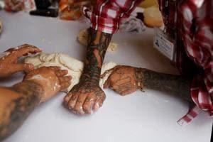 Photos: From thugs to bakers, El Salvador's ex-gang members seek peace
