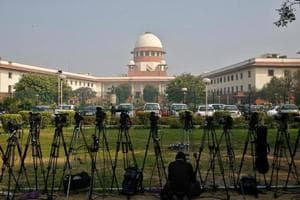 A television journalist sets his camera inside the premises of the Supreme Court in New Delhi. The entire process in Assam is monitored by the Supreme Court is also affecting the smooth functioning of the government machinery as many state officials are engaged in finishing the exercise within the deadline.