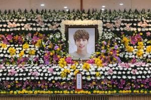 The portrait of Kim Jong-Hyun, a 27-year-old lead singer of the massively popular K-pop boyband SHINee, is seen on a mourning altar at a hospital in Seoul on December 19.