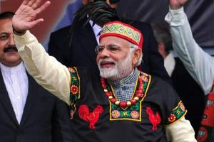 Prime Minister Narendra Modi dressed in traditional Khasi tribe attire and Garo tribe headgear, greets supporters in Shillong on December 16, 2017.