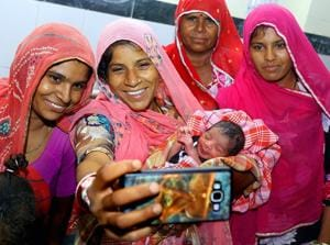 A mother takes selfies with her newborn child at Beawar in Rajasthan. Mother's milk is the cheapest option to reduce infant mortality rate.