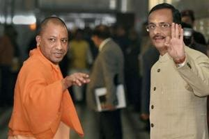 Uttar Pradesh CM Yogi Adityanath (left) and Deputy CM Dinesh Sharma on their way to attend the winter session of UP Assembly, in Lucknow on Tuesday.