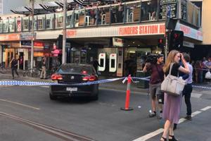 Australian police say up to 19 injured after car rams into crowd in...