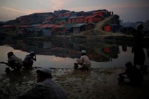 Rohingya refugees wash before evening prayers at the Balukhali refugee camp near Cox